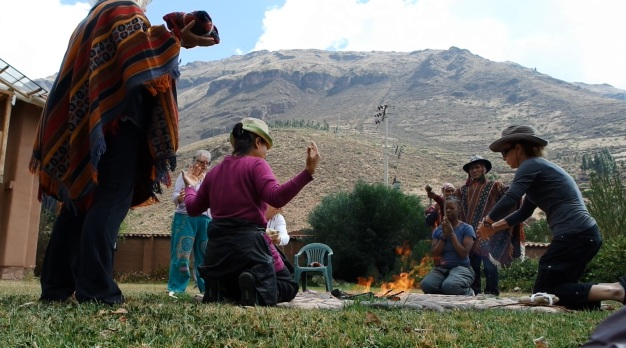 Fire ceremony in Paz y Luz, surrounded by the Apu mountains.