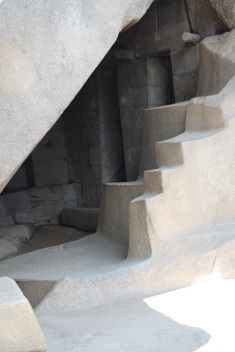 "The internal structure of temple below the Temple of the Sun. Beneath the temple lies a cave, naturally formed, which the explorer Bingham referred to as a ""royal mausoleum,"" although there's little evidence that it was used as such. A boulder carved into a stairway lies near the cave entrance and the underground chamber likely served a religious function of some form."