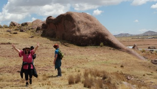 Conquering the back (walking on top) of the HUGE serpent rock behind us. At the mountain region of Southern Peru near Lake Titicaca