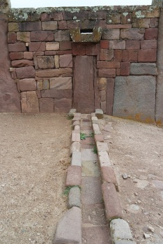 Tiwanaku stone architecture usually employs rectangular ashlar blocks laid in regular courses, and monumental structures were frequently fitted with elaborate drainage systems. The drainage systems of the Akapana and Puma Punku include conduits composed of red sandstone blocks held together by ternary (copper/arsenic/nickel) bronze architectural cramps.